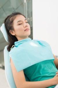 Woman sleeping in dental chair