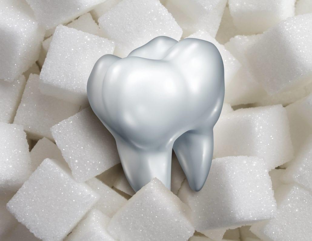 Tooth sitting atop sugar cubes